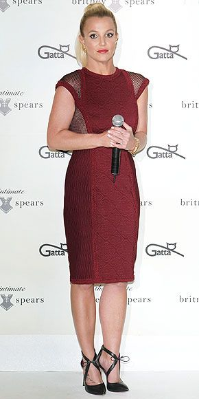 Last Night's Look: Love It or Leave It? | BRITNEY SPEARS | She may be launching her intimates line (in Warsaw, Poland), but it's what Britney's wearing over her lingerie we want to talk about: a fall-ready mesh-paneled Tadashi Shoji dress in burgundy paired with killer lace-up Oscar Tiye heels.