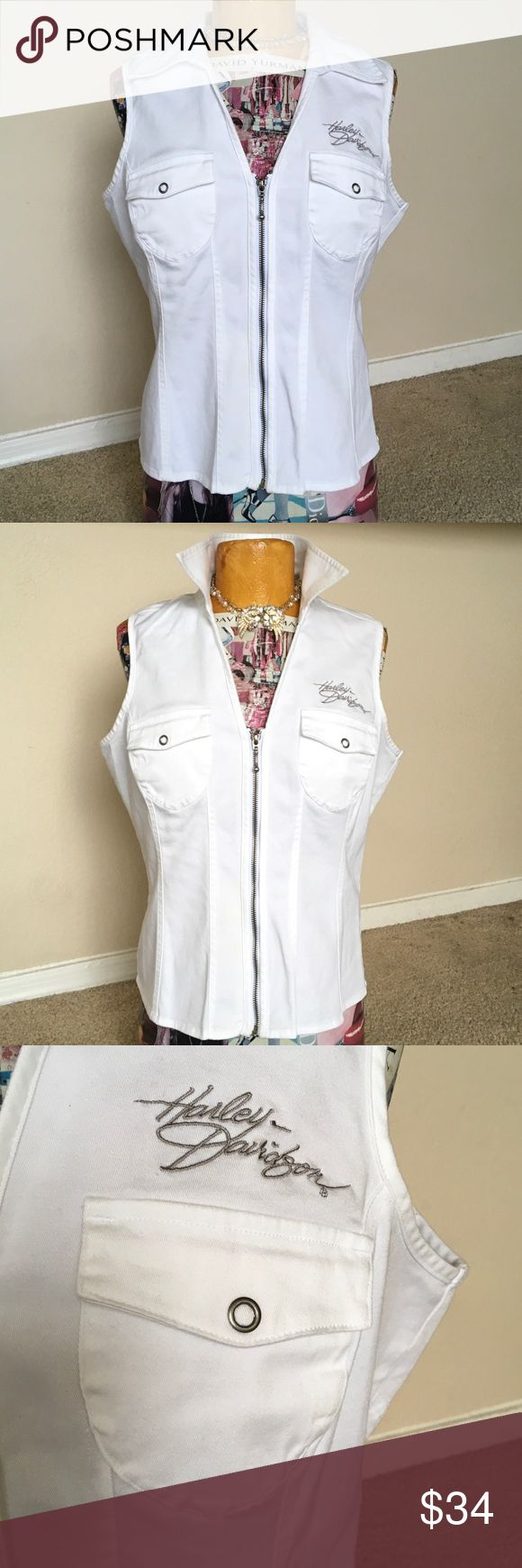 """Harley Davidson white zip VEST Lace up back MEDiUM SOLID White vest w silver white flames 🔥 & studs on back  Front  2 flap pockets w/ HD written in gray. Bottom back laces...some yellowing is on laces but I have sold another exactly like it & it doesn't bother most. M....19"""" UA-UA...21 5/8"""" T-B 🏍🏍🏍 Harley-Davidson Tops"""
