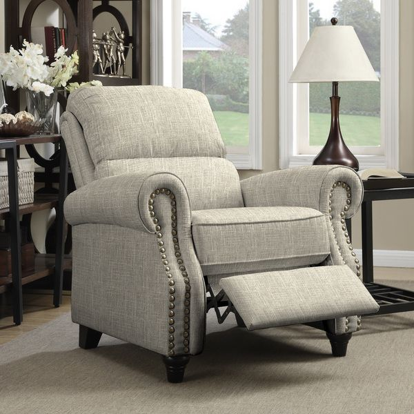 The ProLounger wall hugger recliner is covered in a linen-like barley tan fabric. Sit back and relax in this rounded arm reclining chair accented with hand-tacked antique bronze nail heads. Finish: Da