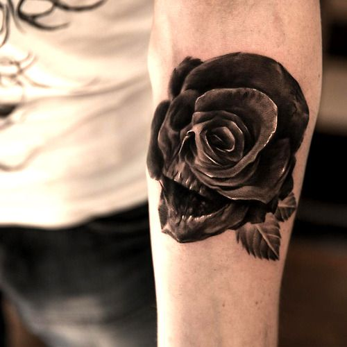Tattoo done by Niki Norberg. Black and white skull and rose