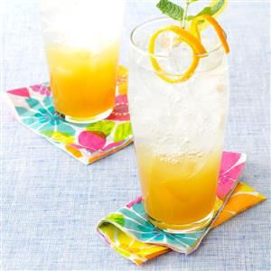 """Ginger-Orange Refresher Recipe -""""A sunset in a glass"""" is how your guests might describe this two-tone cocktail. With or without the spiced rum, it makes a refreshing thirst-quencher for parties any time of year.—Marybeth Mank, Mesquite, Texas"""