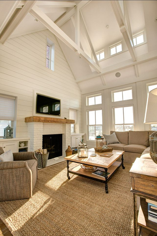 Living Room. I am liking this neutral living room with a subtle coastal decor. Painted brick