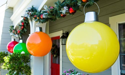 Giant ornaments made with large plastic ball, deli containers that have been spray painted, wire or coat hanger, and aquarium silicone or glue.  Clever!