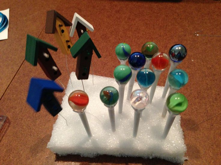 Make your own fairy garden gazing balls from marbles, golf tees and glue.