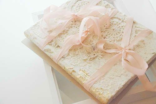 Lace cover with pink bows.
