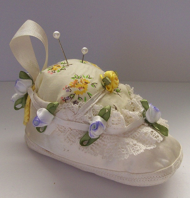 Great idea to put to use those shoes we all saved. Sweet baby shoe pin cushion