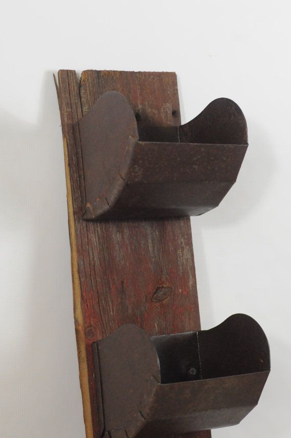 Up for your consideration is a set of three grain scoops on antique brand.  Fabulous wall decor or garden decor.  The three bins were put on brand that came from an 1860s Indiana barn.  Great item for sorting mail, storing car keys or possibly a place to park cell phones during family dinners.  Made of a heavy metal iron, very strong and sturdy.  There is wear, dents, dings, and generalized surface rust.  There was fairly wide spread surface rust which created a fabulous patina.  Entire…