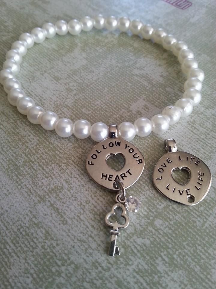 Follow your heart, pearls with key and clear gem. Pearls were worn by medieval knights going into battle to protect them from harm. Your daughter, girlfriend or other special someone you want to look after will prize this beautiful pearl bracelet as much as royalty did in the Middle Ages.