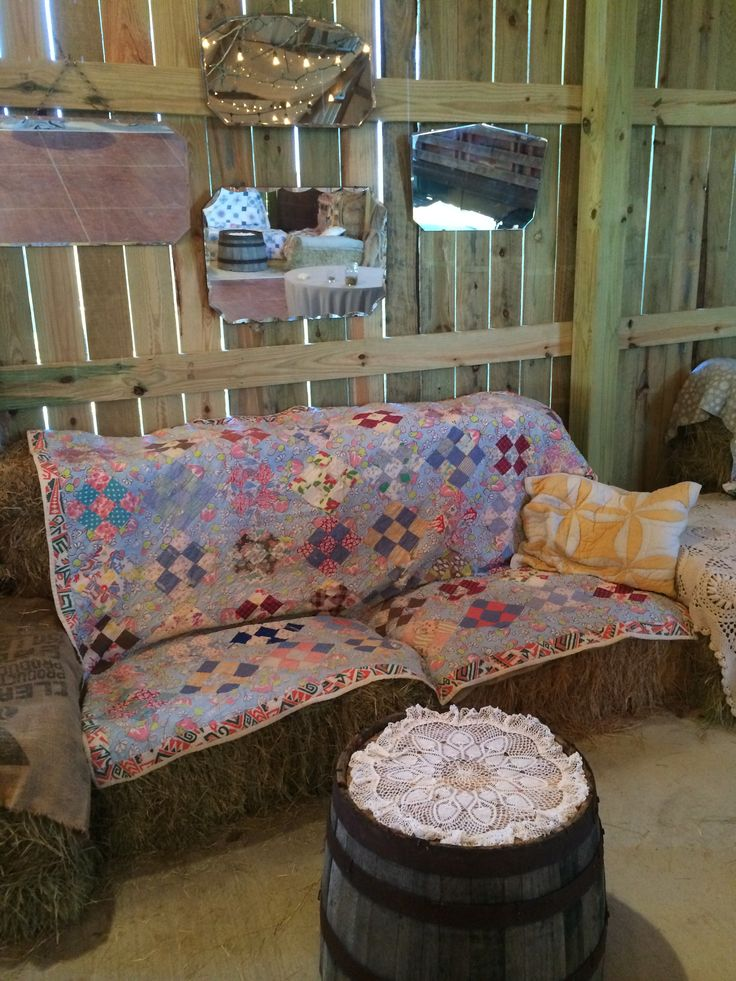 Haybale seating with vintage quilts great around the dance floor at a rustic wedding
