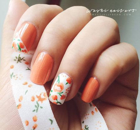 Just couldn't help it. Had to share my growing obsession with washi tapes through this nail art. Hope you like it ;) check out the how to here: http://sweetjellybean.com/2014/09/15/floral-washi-inspired-nail-art/