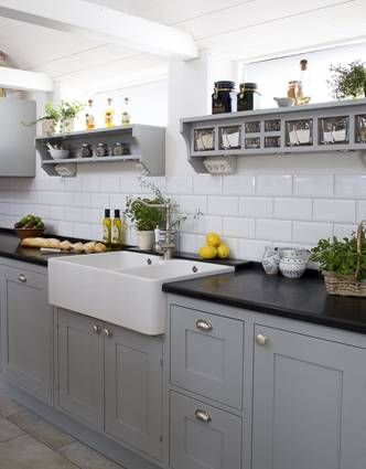 Grey cabinets/farmhouse sink (Subway tile backsplash would be an inexpensive option)