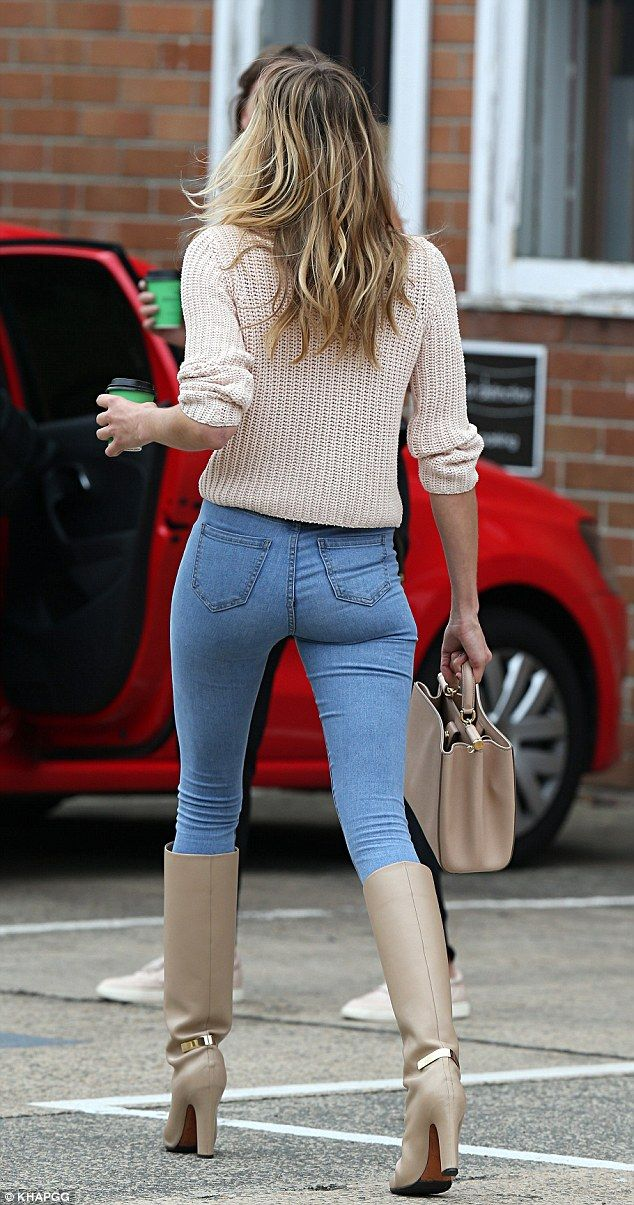 Jessica Hart flaunts pert derrière in tight jeans and knee-high ...