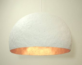 Chalk white modern hanging light by Rough Hands The Hague #RH-PP007  Look & Feel __________  This chalk white paper mache lamp by Rough Hands The Hague, is the ultimate in white interiors! A true snow white finish on both in- and outside makes this one stand out from the crowd. Therms like, clean, minimalistic, chalk or snow were running through our heads when creating this one of a kind lampshade. due to its all natural color this lamps feels at home in many many different interiors, from a…