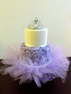 Baby shower lavender and white princess tiara cake with matching lavender tutu cake board. Buttercream cake, gumpaste tiara. Tutu Cake blog post at: http://caketalkblogger.blogspot.com/2015/04/tutu-cake.html Board available at: https://www.etsy.com/listing/227647069/tutu-cake-board-includes-free-usa?ref=shop_home_active_5