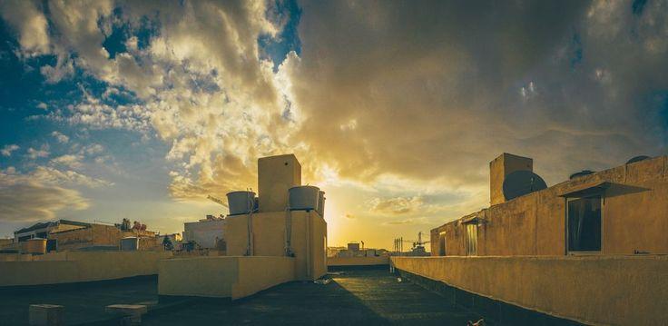 Rooftop sunset by Torbjørn Schei