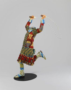 Yinka Shonibare MBE (b. UK, 1961). Skipping Girl, 2009. Life-size fiberglass mannequin, Dutch wax printed cotton, mixed media, installed: 50 1/4 x 29 x 43 in. (127.6 x 73.7 x 109.2 cm) height measured from top of proper left hand; width measured from elbow to the rope in proper right hand; depth measured from the front of the back to the back of the rope. Brooklyn Museum, Gift of Edward A. Bragaline and purchase gift of William K. Jacobs, Jr., by exchange and Mary Smith Dorward Fund, 2010.8.