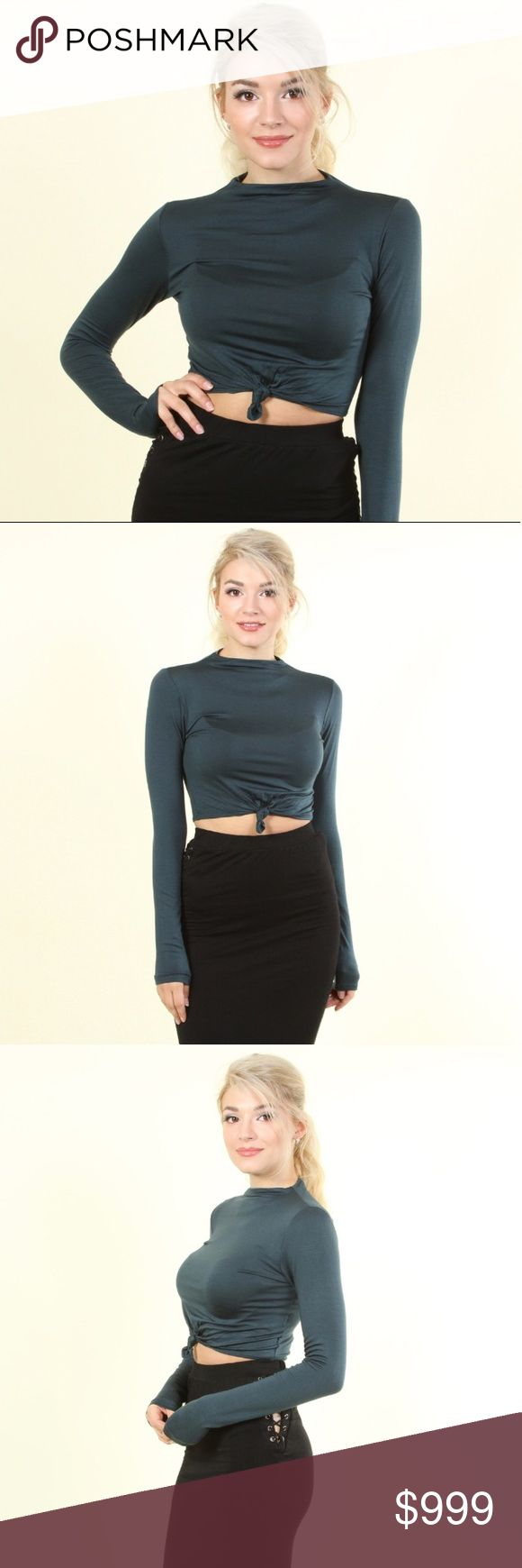 **COMING SOON** Knotted Crop Top The color is dark teal.  Super soft solid rayon jersey long sleeve crop top with tie-knot center and high neck. 96% rayon, 4% spandex.   Pair this with a high waisted skirt or jeans. Super cute for winter ladies!! Tops Crop Tops
