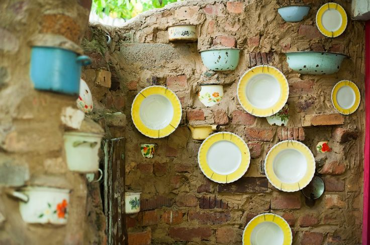 Old enamel pots and yellow plates