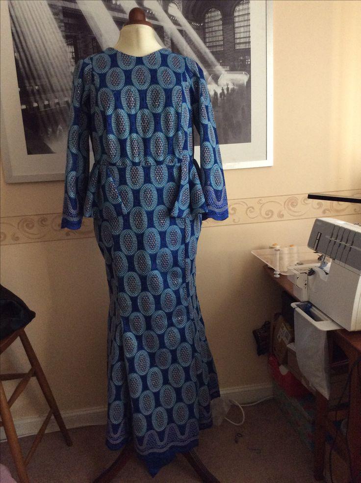 Blue lace long sleeve dress style with side peplum.