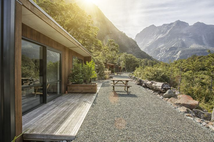 The Mountain View Chalets at Milford Sound Lodge, in Fiordland National Park, is a stunning place to unwind with a glass of wine. #NewZealandwalkingtours #WalkingNewZealand #NewZealandVacations #MilfordSound #Fiordland