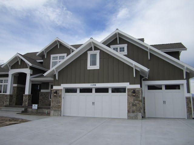 colors, variation in siding, lanterns flanking garage, trim on top of garage doors, gables, addition of 3rd car garage