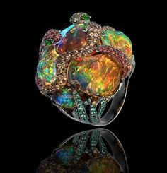 Lydia de Courteille opal ring with fire opals, sapphires, green garnets in black rhodium plated white gold.