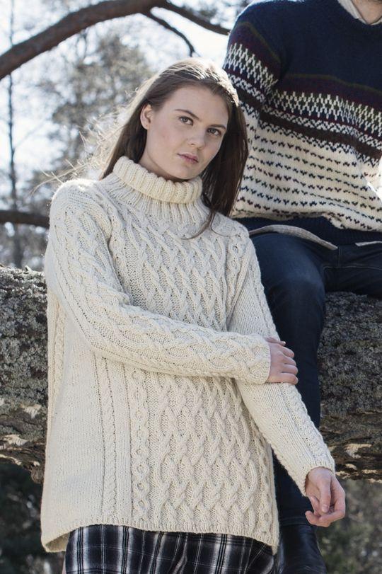 This casual and warm pullover is knitted in Novita Suomivilla (Finnwool) yarn. Sleeves and front of this A-line knit are embellished with cable pattern. Let the winter come for the owner of this pullover! | https://www.novitaknits.com/en | Novita Fall 2015