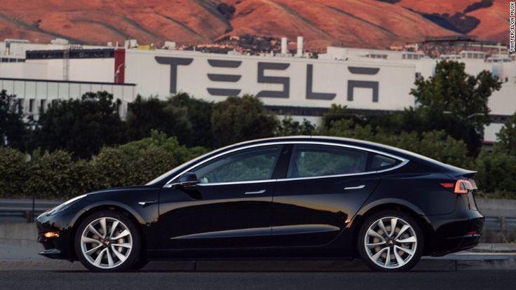 Elon Musk shows off Tesla's first Model 3