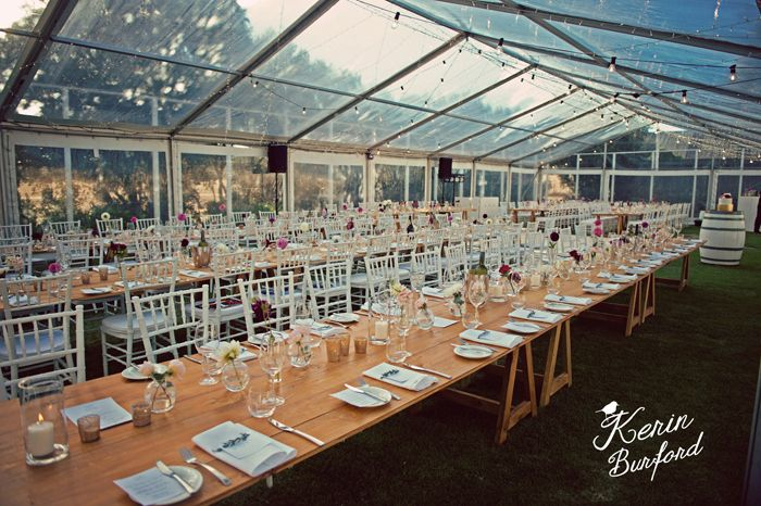 T&D wedding #clearroof #marqueewedding #naturalwood #woodentable #whitechiavarichair