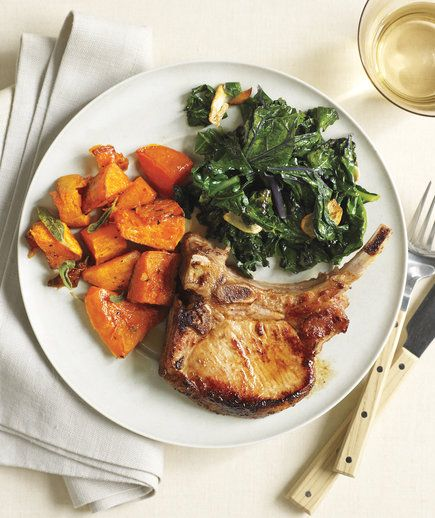 Roasted Pork Chops and Butternut Squash With Kale | Thanks to these easy, healthy dinner recipes, you can solve the mystery of what to make tonight (and all those busy nights to come).