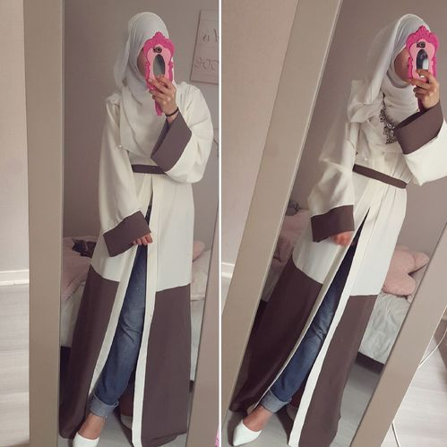 I thought the pink was the edge of her hijab. Still cute though!!