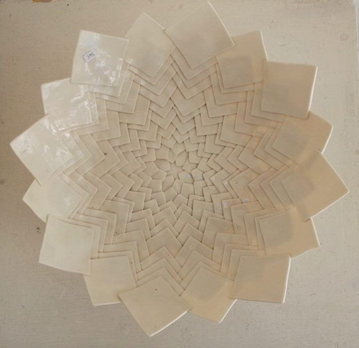 Ayala Sol Friedman. I utterly love this piece. It seems to have been formed by stacking very fine squares of porcelain to make that amazing delicate pattern. I am blown away!