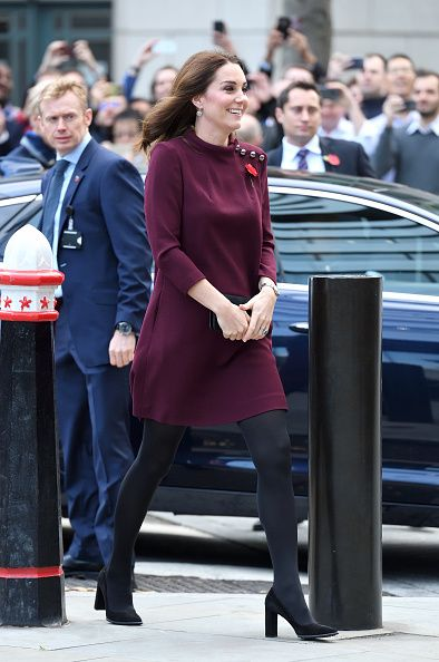 Catherine, Duchess of Cambridge looks blooming in burgundy as she sports a loose-fitting dress to attend a mental health forum in London ...