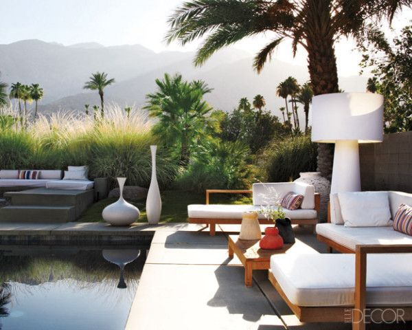 The pool area of a Palm Springs, California, home, surrounded by desert plantings and views of the San Jacinto mountains.
