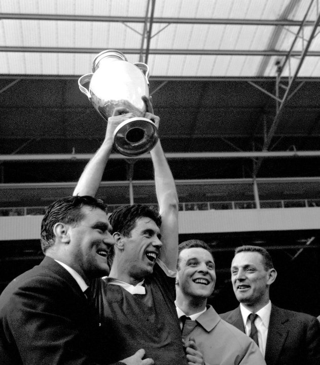 AC Milan captain Cesare Maldini holds the European Cup after his team's 2-1 victory.