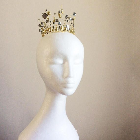 This unique and one of a kind small gold crown or coronet has been designed as a period costume piece or headdress for an alternative bride looking for a gold or gold and grey colour theme. Designed fairly small, it can be either worn on top of the head as an actual small crown, or around a hair bun or chignon. It would make a fabulous diadem headdress for a medieval queen, but would also be great as a fairytale wedding headpiece. If you like a bit of sparkle in your hair, and are looking…