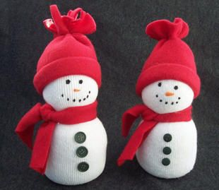 Sock Snowman | Easy kids craft | Winter Crafts....Fun craft, we did it at Story Time at the local library...and have done it every year since for Halloween, Christmas and Winter in general...pumpkins w/ orange socks, snowmen w/ white socks and penguins w/ black socks!!!!