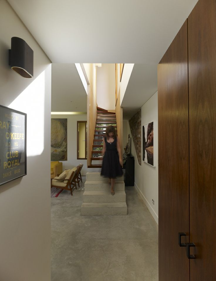 (c) Brett Boardman  Architecture, Entry, Stair, Robe, Wall Light, Concrete, Plywood, Timber  http://www.samcrawfordarchitects.com.au/campbell-house-2/#