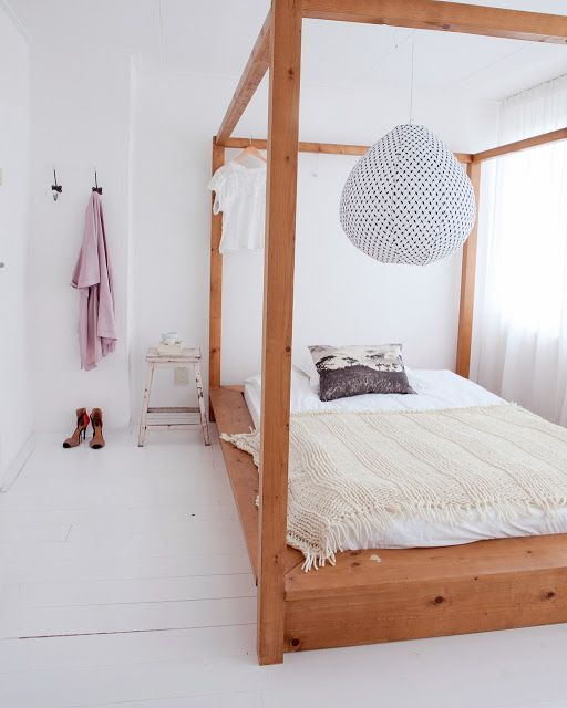 I love how much the white respects and enhances the beautiful natural wood in this Danish bedroom.