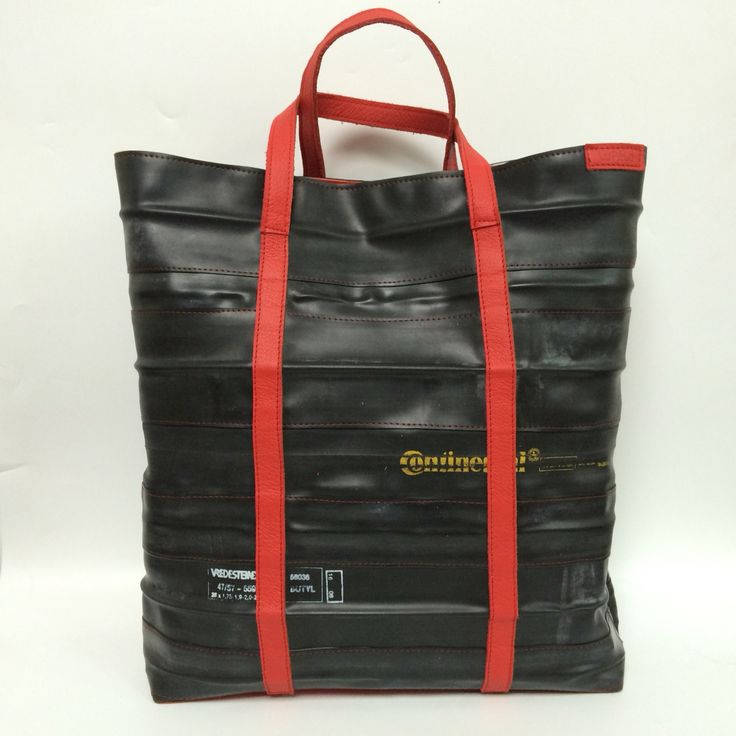 Big shopper, made of innertubes and red leather. Lining sail of the sailboat!