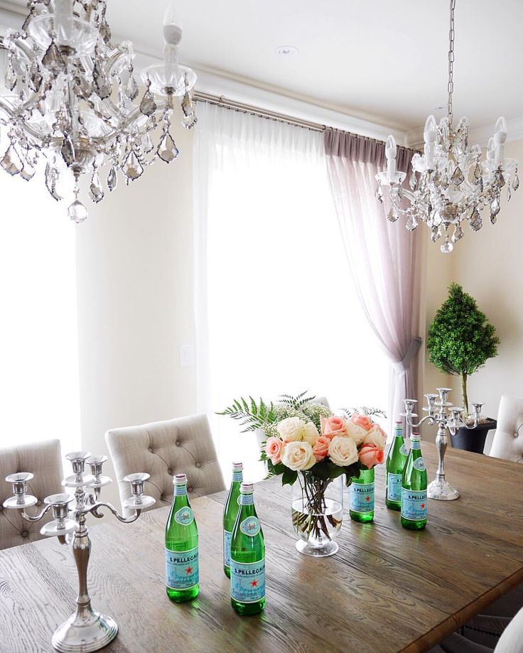 Double Chandelier Above Dining Table