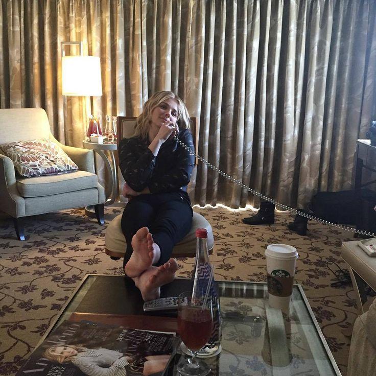 Chloe Grace Moretz putting her feet up..