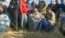 A trio of International Space Station crew members returned to Earth and landed in Kazakhstan at 10:23 p.m. EDT on Sept. 10, 2014 (8:23 a.m., Sept. 11, in local time) after spending 167 days aboard the orbital laboratory. Seen left to right, Oleg Artemyev and Alexander Skvortsov of the Russian Federal Space Agency (Roscosmos) and NASA's Steve Swanson were examined by medical personnel after being removed from their Russian Soyuz spacecraft.