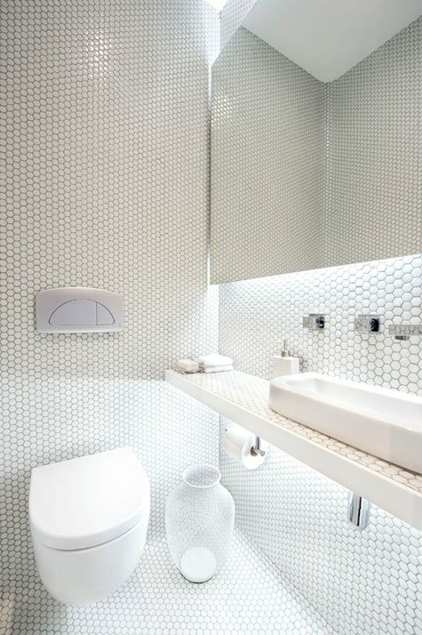 WOAH love this white modern tile bathroom. #mosaic #stone #bathroom #tiles #interiordesign #penny #round available at Cerdomus