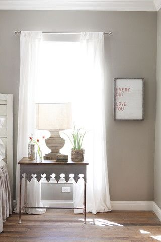 Love everything about this! There are just enough pops of color & the linen curtains are so beautiful! So airy and light.