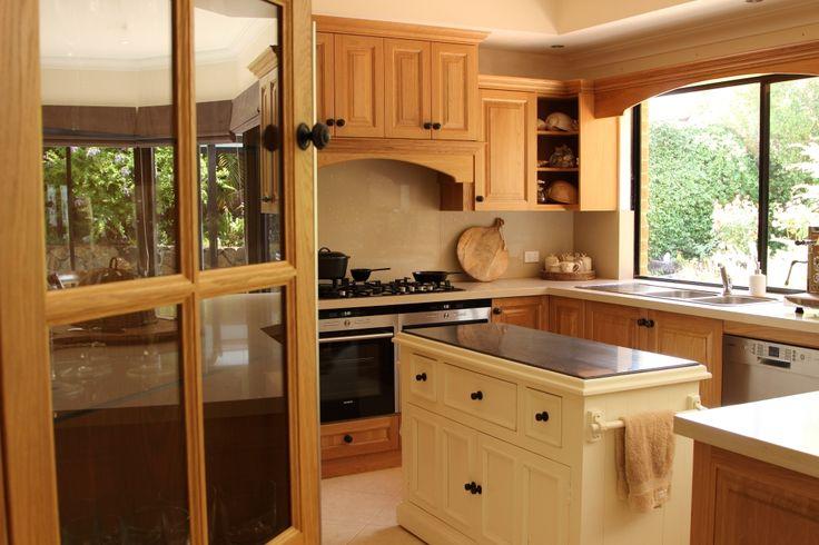 American oak kitchen with granite top island bench
