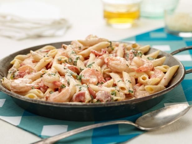 Giada's Penne with Shrimp and Herbed Cream Sauce - Shrimp and tomatoes tint the creamy pink sauce coating this top-rated penne, and fresh basil gives the dish a burst of summer flavor. http://www.foodnetwork.com/recipes/giada-de-laurentiis/penne-with-shrimp-and-herbed-cream-sauce-recipe-1943967