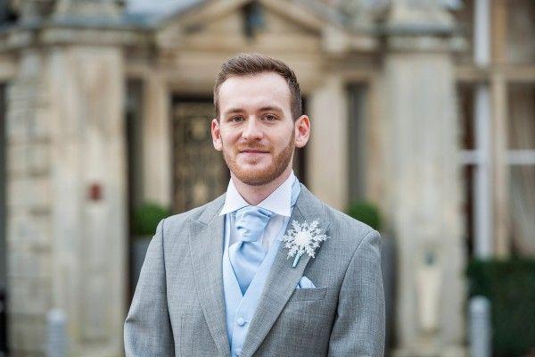 groom wearing grey wedding tails suit  with sky blue cravat  Luisa_Ronan_Winter-Wonderland-Wedding_007