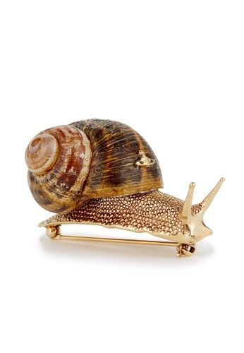 Delving into Vivienne Westwood's jewellery archive, this Spring/Summer 2014 the Snail collection makes a return from the Spring/Summer 2002 Nymphs collection. Quintessentially English, the Snail Brooch, delicately produced from a real snail shell, beautifully creates the suggestion of back gardens after the summer rain.