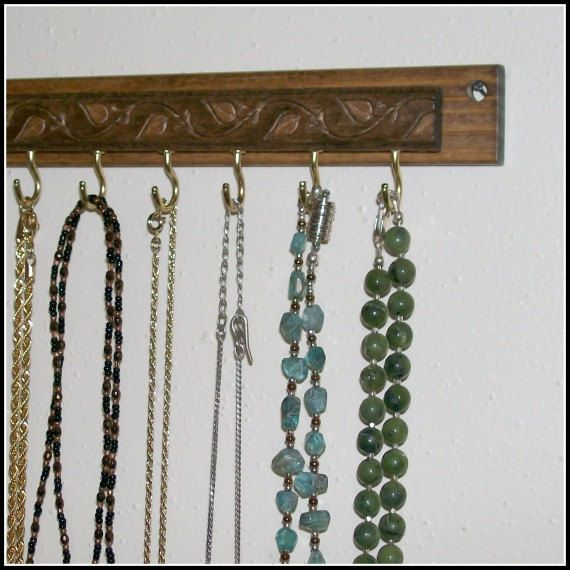 I think I can create this look by using a belt on top of the board. Have to try it. Leaf  Necklace Hanger  Organizer